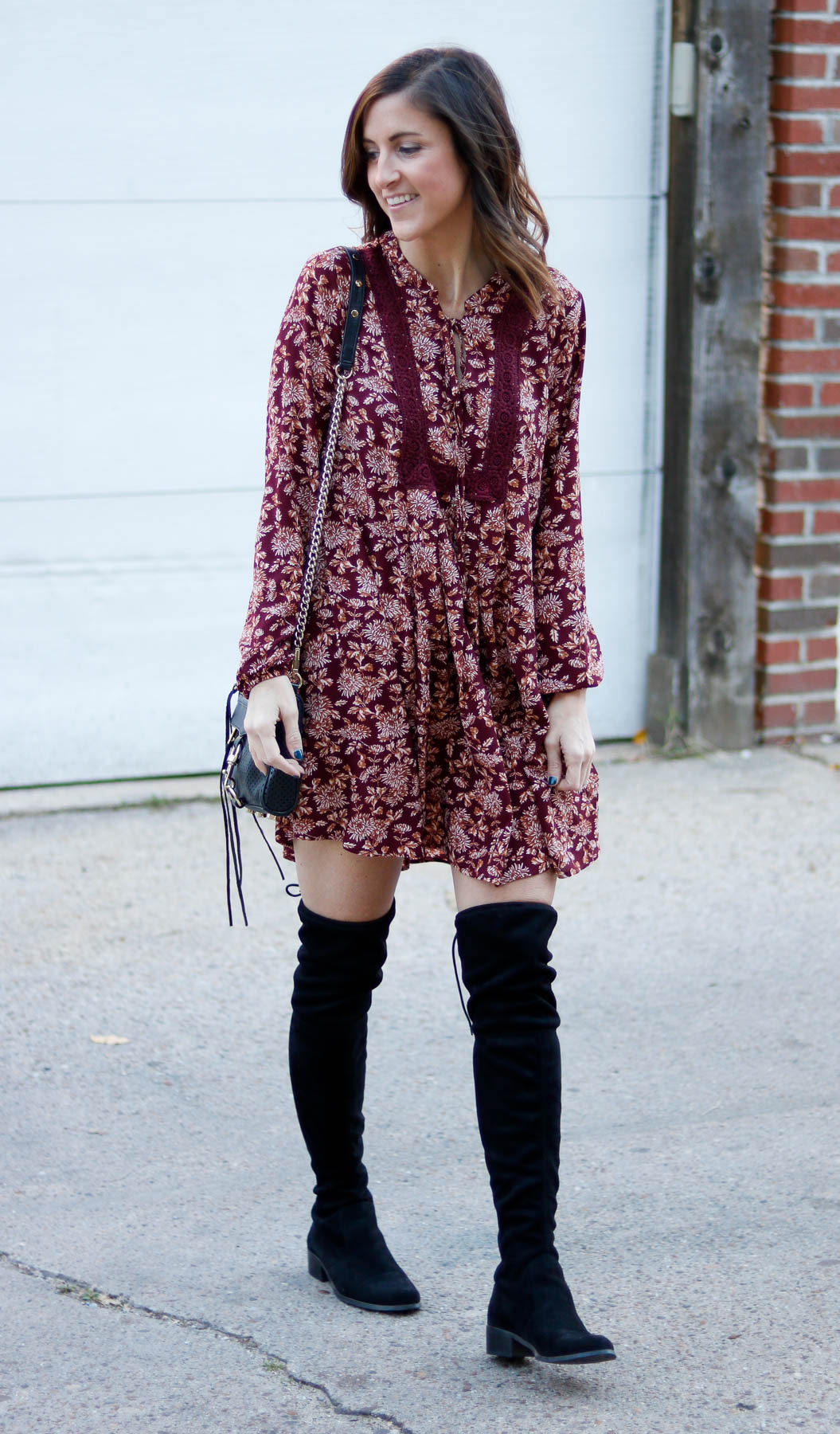 Gray Monroe maroon long sleeve dress paired with over the knee boots.