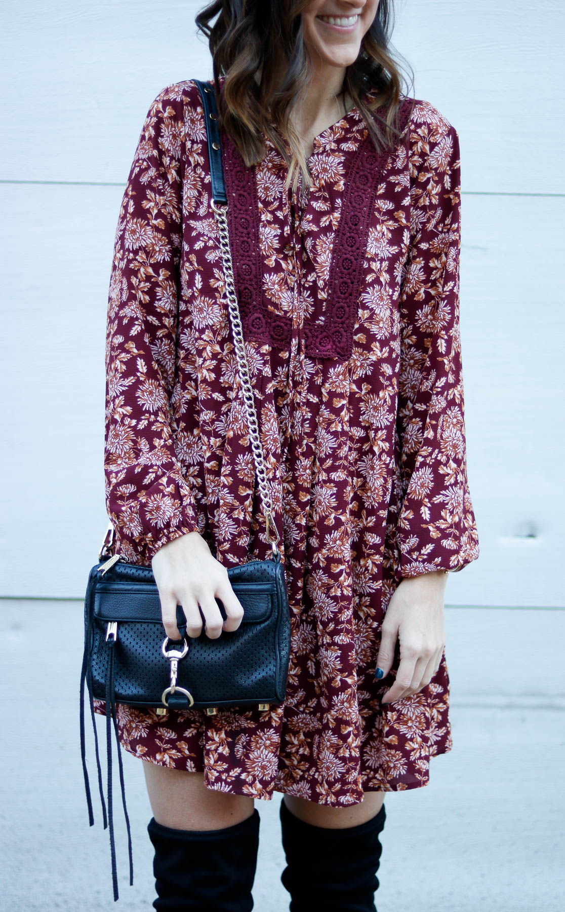 Maroon long sleeve dress with over the knee boots.