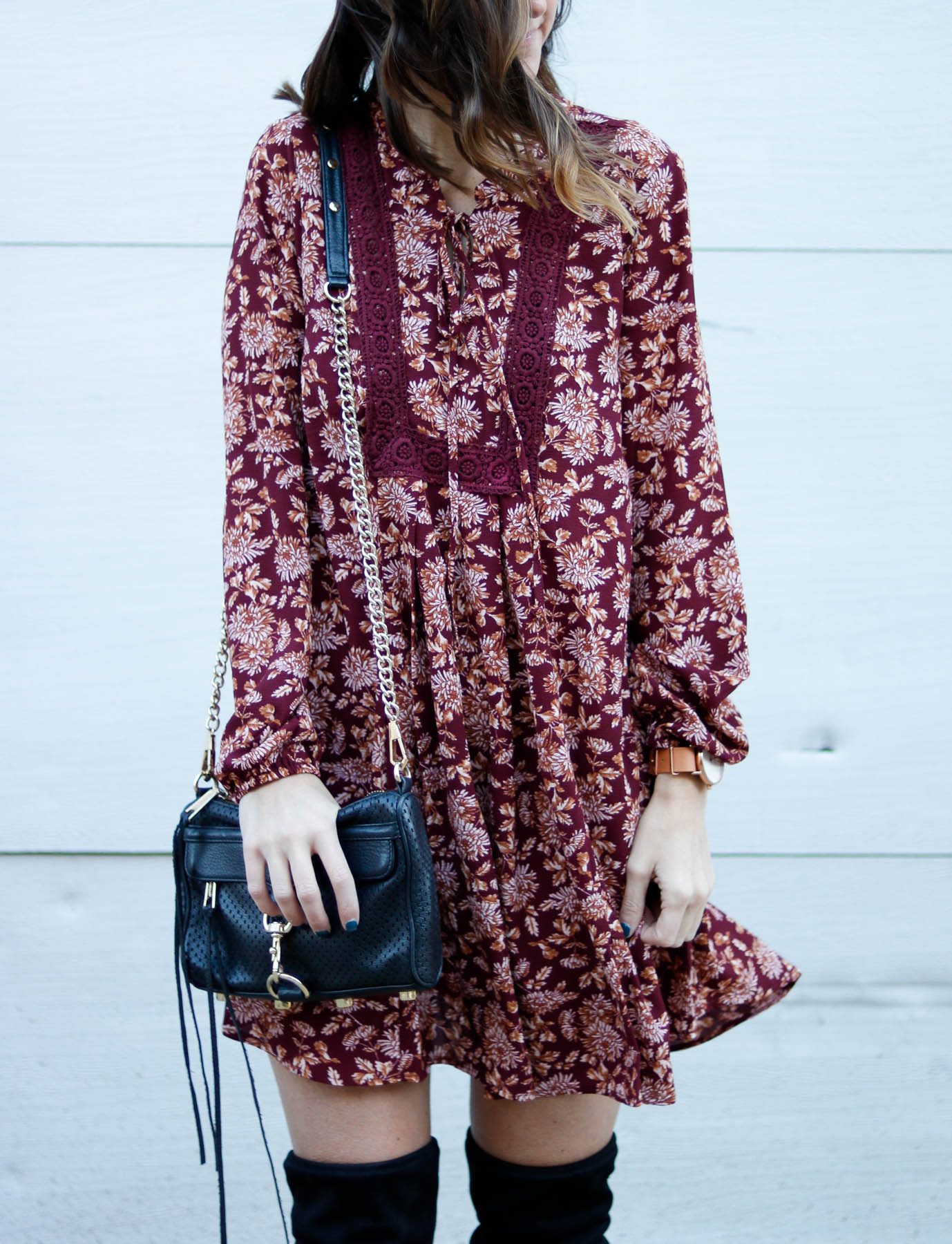 Maroon long sleeve dress paired with over the knee boots.