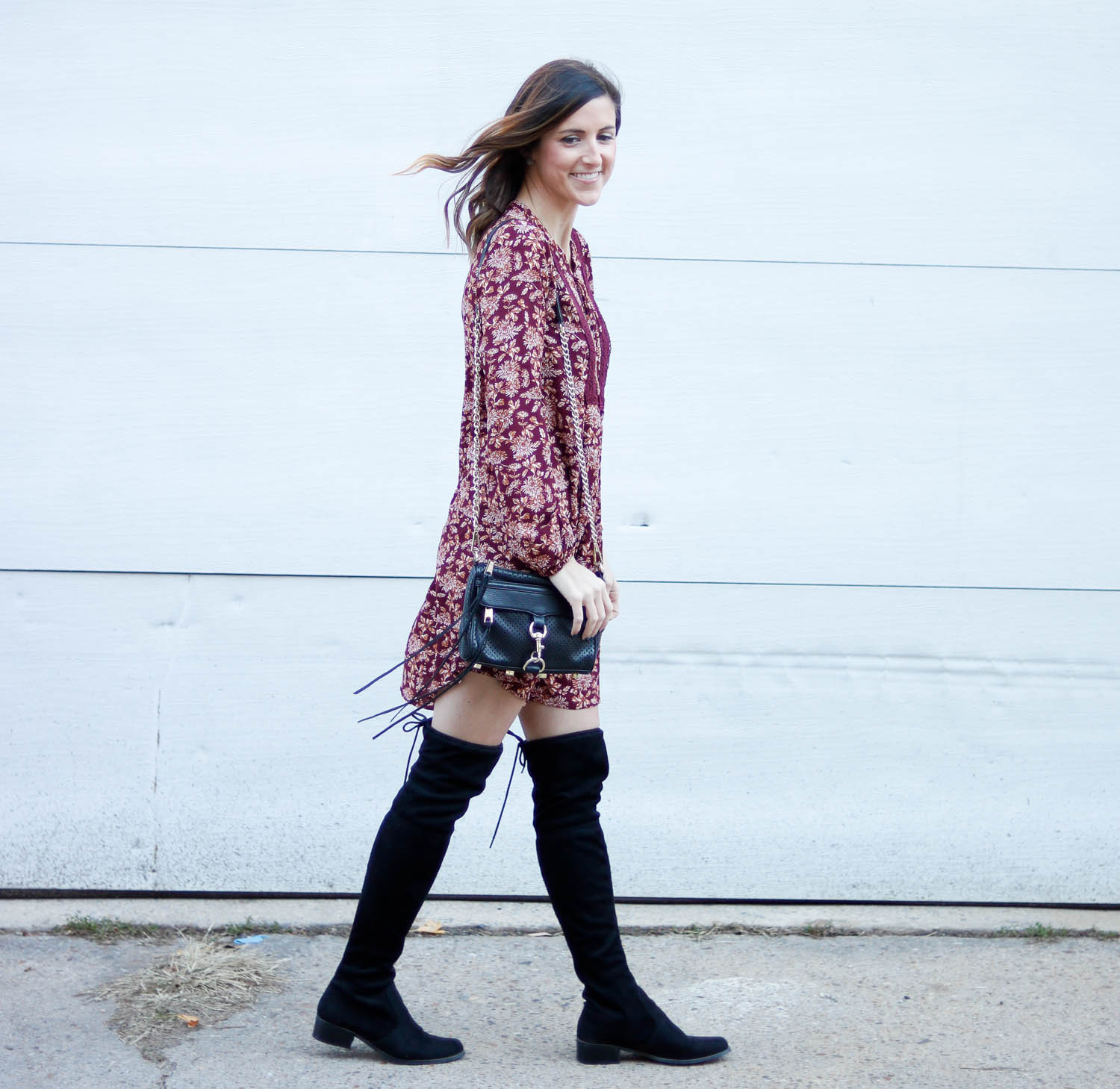 Maroon dress paired with over the knee boots and a Rebecca Minkoff bag.