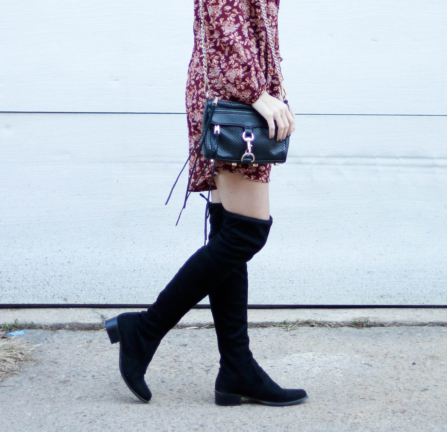 Black over the knee boots paired with a short dress.