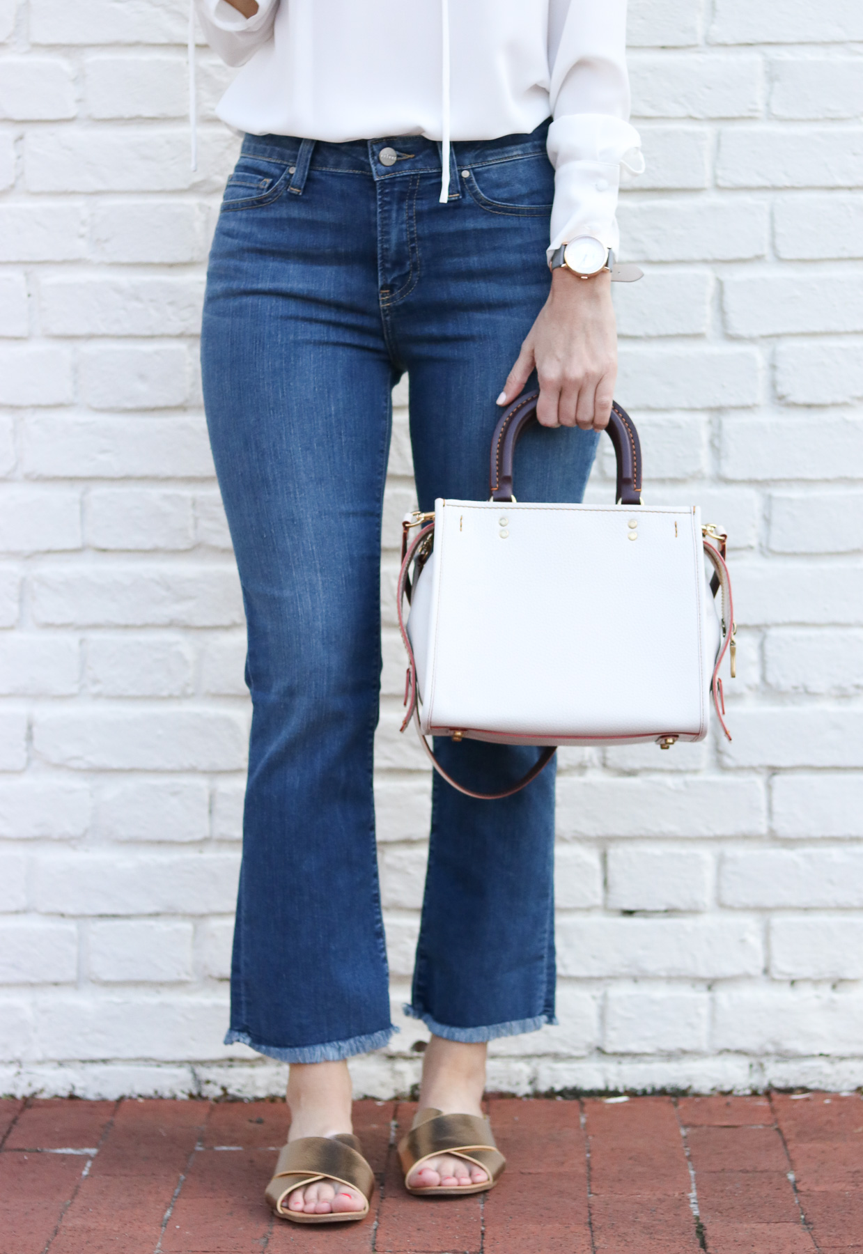 White Coach Bag - Cropped Flare Denim - Lace Up Top @cobaltchronicle